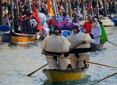 ITALY - Carnival in Venice - January 30, 2017:  Venetians row during the masquerade parade on the Grand Canal during the Carnival in Venice, Italy.