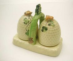 Beehive Salt & Pepper Set with stand-circa 1930s  The classic Shamrock pattern, produced in Japan for the European market in the 1930s. Sweet pots, both have winged bees. Nice S set with a history.Base stamp printed-Foreign  The Hive Honey Shop : Antique,Rare Honeypots