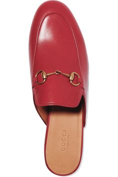 Crafted in Italy in the must-have shape of the season, Gucci's slippers have a softly padded insole and are fully lined in leather for lasting comfort. Topped with the iconic horsebit plaque, they look particularly cool with cropped jeans and midi hems.