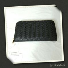 """BLACK WOVEN CONTINENTAL WALLET Neiman Marcus woven continental wallet in faux -leather ( polyurethane ) Zip around closure. Multi card slots. Two bill slots. Two multi use slots. Sectional zip pocket. Exterior welt pocket. Approx 4 1/2"""" (H) 7 1/2"""" (W) 1"""" (D) Neiman Marcus Bags Wallets"""