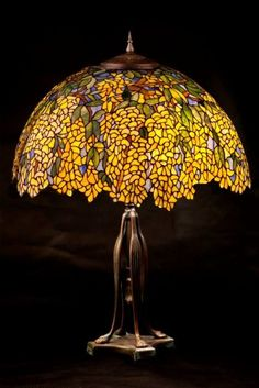 Tiffany Odyssey stained glass lamps and custom designs. Stained Glass Table Lamps, Tiffany Stained Glass, Tiffany Glass, Antique Lamps, Vintage Lamps, Chandelier Design, Spectrum Glass, Tiffany Table Lamps, Touch Lamp