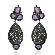 Earrings in 18k blackened gold with natural carved jade, pink sapphire, and black diamonds, $10,500; Sutra Jewels