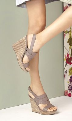 Taupe leather platform wedge sandals with a stacked heel and adjustable slingback closure