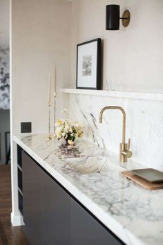 Minimal kitchen sink with marble slab backsplash and burnished brass faucet on Thou Swell While home decor trends are always a bit subjective, I love looking out for movements in the design world from experiences like High Point and my Kitchen Worktop, Kitchen Backsplash, Kitchen Countertops, Backsplash Ideas, Backsplash Marble, Island Kitchen, Countertop Types, Vanity Backsplash, Sink Countertop