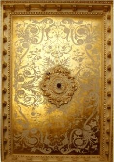 Gold gilded ceiling with a pattern using a flat plaster...even some of the trim is tipped in gold.