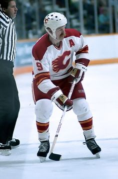 Lanny MacDonald of the Calgary Flames skates up ice against the Toronto Maple Leafs during NHL game action on February 20 1986 at the Calgary. Hockey Logos, Ice Hockey Teams, Hockey Stuff, Hockey Puck, Calgary, Lanny Mcdonald, Flame Picture, World Icon, Hockey Party