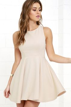 The Gal About Town Beige Skater Dress is perfect for the busy girl who gets invited to everything! Textured stretch knit forms a sleeveless bodice with princess seams above a flirty skater skirt. A single gold button tops an open back. Hidden back zipper/hook clasp.