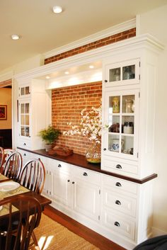 On window wall - so windows in place of brick? And cabinets up to ceiling. Farmhouse Kitchen Design. love the exposed brick for the buffet area