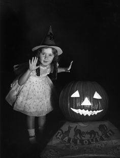 Vintage Halloween Photograph witch costume girl and pumpkin