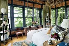 In the master bedroom of a Thom Filicia–decorated upstate New York getaway, a twig chandelier hangs above a custom-made Murray's Iron Works four-poster; the curtains are of a Groundworks wool, the étagères are by Mecox, and the rug is from Safavieh's Thom Filicia Home Collection;  10 Rustic Bedrooms