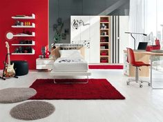 I like this music bedroom idea, except I'd change red to blue, and replace that guitar with a piano somehow . . . :D