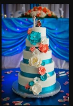 Coral and turquoise wedding cakes