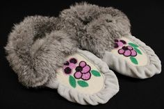 Grey hide with white toe and pink, purple, and green beaded flower design. Grey rabbit trim.