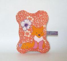 orange flower fox - pincushion. $18.00, via Etsy.