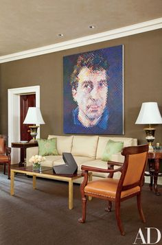 Designer Thomas Jayne convinced the couple to line the living room walls in a chocolate-brown Holland & Sherry cotton, providing a distinctive backdrop for the large Chuck Close portrait Bill and other artworks, including a tabletop sculpture by Tony Smith | archdigest.com