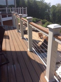 Lighted deck rail posts and cable inserts provide a contemporary style to this low maintenance Trex deck.