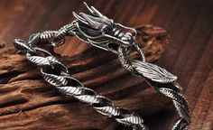 Mens Sterling Silver Jewelry: buy fashionable & stylish cheap mens silver jewelry including rings, bracelets, necklaces & chains made of 925 sterling silver. Mens Silver Jewelry, Gold And Silver Bracelets, Bracelets For Men, Silver Necklaces, Sterling Silver Jewelry, Silver Rings, Silver Chains, 925 Silver, Dragon Bracelet