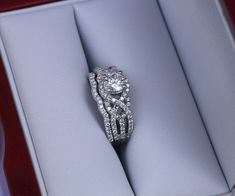"I can't get enough of this ""twist of fate"" engagement ring. Seriously the most perfect ring"