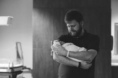 dad holding new baby, birth photography, south carolina birth photographer, new parents, photography