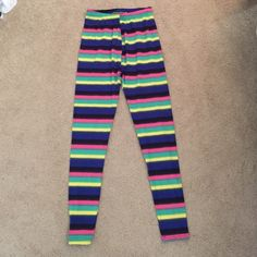 Neon striped leggings NWOT. Super soft material (kinda feels like butter)! Never worn. Given as a gift. Not from Nike, just need the views :) no size listed but guessing small/medium Nike Pants Leggings