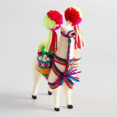 Small in size but big on charm, our woolly white llama is handmade by artisans in Peru. Outfitted with woven baskets and accented with pom poms in bright, traditional colors, this delightful figure brings Peruvian appeal to your tabletop. Crafts To Sell, Crafts For Kids, Arts And Crafts, Diy Crafts, Alpacas, Llama Alpaca, Baby Alpaca, Christmas Makes, World Market