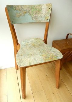 modge podge an old map to a chair--I love map crafts