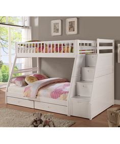 House multiple sleepers in efficient style with this bunk bed boasting a low-profile design. The convenient staircase makes reaching the top even easier.