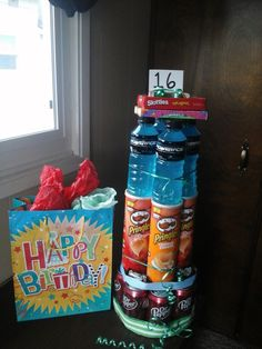 """There are lots of cool """"food cakes"""" out there that are great ideas for birthday gifts…especially for teenage boys! This post is a little bit about my try at making a """"food c… gift for teen Teenage Birthday Gifts, 16 Birthday Presents, Boy 16th Birthday, Birthday Basket, Gifts For Teen Boys, Birthday Cakes For Teens, Best Birthday Gifts, Diy Birthday, Happy Birthday"""