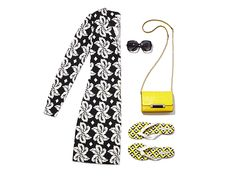 Summer Must-Have: The Reina Tunic. In bold black-and-white floral print, the Reina pairs beautifully with sunny yellow accessories. Learn about the full look on World of DVF now: http://on.dvf.com/1LNes4m
