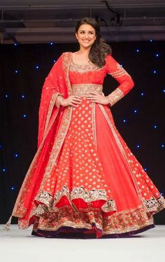 Glimmer and glow under the spotlight like Parineeti Chopra in this gorgeous red number.