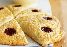 Coconut Scones   1 3/4 cups all-purpose flour  1/2 cup sweetened flaked coconut  1/2 cup rolled oats  3 tablespoons granulated sugar, divided  2 teaspoons baking powder  1/4 teaspoon salt  1/3 cup cold butter, cut into chunks  2 large eggs  1/2 cup milk  1/4 cup raspberry or cherry jam