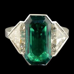 HANCOCKS London.Colombian 3.74cts.Impressive Colombian emerald and diamond ring