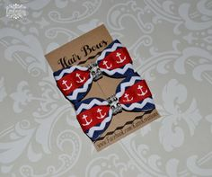 This listing is for a Ready to Ship Super Cute set of two Red and Navy Nautical Anchor Piggie hairbows Made using high quality grosgrain ribbon