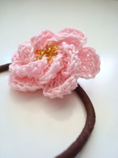 crochet tea rose for pony tail holder but could be used on a baby dress or hat.