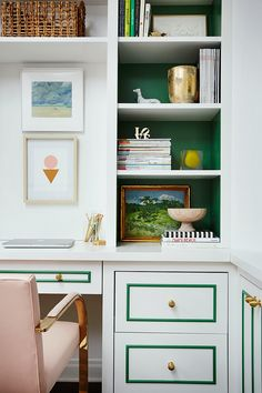 painting inside of bookshelves . love the green trim on the desk too. home office inspiration