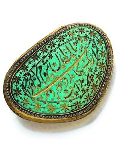 A late 19th century box. The hammered yellow gold box adorned with a turquoise plate engraved with floral and Oriental calligraphy motifs, the edges set with a line of rose-cut diamonds mounted in silver. #antique #box