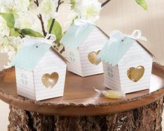 "Love Nest"" Bird House Favor Box (Set of 24) Wedding  Declaring your love, sharing a home and making a life together is what this day is all about. This enchanting favor expresses every meaning of the day to perfection. The clear-display, heart-shaped windows give guests a peek at the sweetness inside"