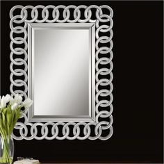 Buying Highlights:      Frame is constructed of curved bevel mirror...