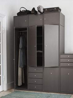 Montana Wardrobe in the colour Coffee. Montana Wardrobe is a flexible storage solution that allows you to express your own personal style, colour scheme and needs when designing your wardrobe. Living Room Tv Cabinet, Ikea Living Room, Living Room Shelves, Living Rooms, Wardrobe Furniture, Cool Furniture, Furniture Design, Wardrobe Storage, Locker Storage