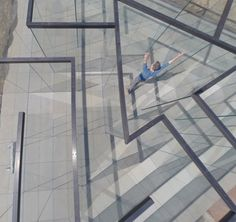 Glass panes form transparent labyrinth by Robert Morris.