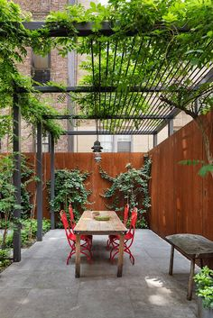 Stunning Revival of a NYC Townhouse by O'Neill Rose Architects The outdoor space is anchored by a custom steel trellis.The outdoor space is anchored by a custom steel trellis. Trellis Design, Trellis Ideas, Wooden Pergola, Outdoor Pergola, Backyard Pergola, Metal Pergola, White Pergola, Small Pergola, Deck Patio