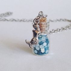 """Mermaid Scales Necklace 🐚 30"""" silver chain necklace with a tiny vial of shiny mermaid scales.                                                      NOW AVAILABLE IN PINK, PURPLE, OR BLUE!                                                                No mermaids were harmed in the making of this jewelry!                                                                                                                 All orders ship same or next business day, carefully packaged with confetti…"""