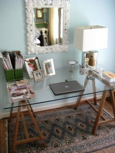 DIY Sawhorse Desk With A Glass Top. Could be an awesome computer desk