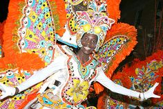 HOLIDAYS(student choice): The Bahamian in this photo is posing in one of the elaborate costumes designed for the famous Festival of Junkanoo. This is a street carnival with music, dancing, and parades. The festival takes place every New Year's and December 26th, with the biggest celebration taking place in Nassau. It's in honor of the only time period when African slaves had freedom, and because most of the population is African American, this is a huge deal there.