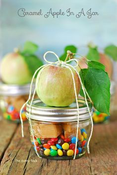 Caramel Apple In A Jar~T~ This is a great idea for a party favor or gift. Caramels and M&Ms in the jar with apple tied on top with a lollipop stick. Caramel can be melted in the jar, dip apple in melted caramel then roll in candies or nuts. Include instructions for heating and assembling on a tag.