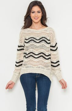 Round neck long sleeve metallic accented embroidered stripes knit sweater.  Price Per Piece $22.75