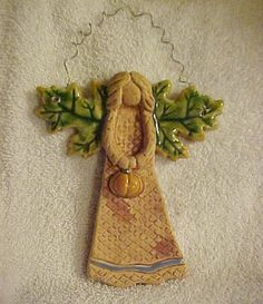 Love this little Fall pottery angel! Like the hanger!