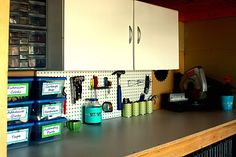 garage- is it bad that I'm in LOVE with this tool area's organizational bins??  I see a project in my future!!