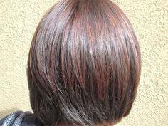 Copper highlights on dark brown hair