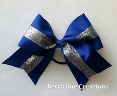 Big 6 inch Royal Blue and Silver Glitter Hair Bow perfect for a cheerleader, softball or soccer player. attached to ponytail holder.  Team Specials Available. Message me for more details.